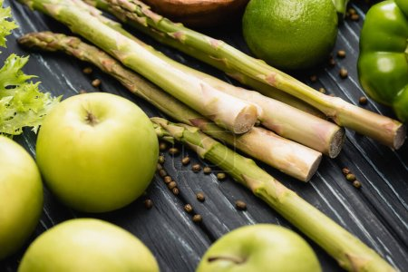 fresh green ripe apples and asparagus on wooden surface