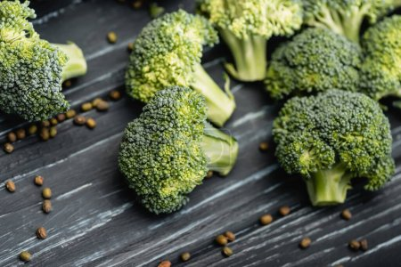 Photo for Close up view of fresh green broccoli on wooden surface - Royalty Free Image