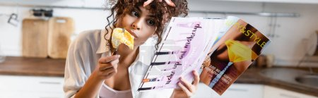 Photo for Panoramic crop of woman eating fried eggs and reading magazine - Royalty Free Image