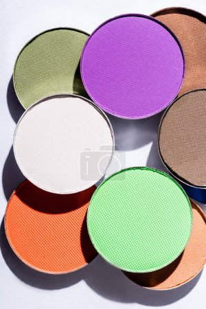Photo for Close up view of multicolored eyeshadow on white background - Royalty Free Image