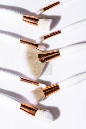 top view of cosmetic brushes set on white background