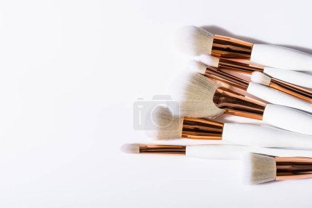 Photo for Top view of cosmetic brushes set on white background with copy space - Royalty Free Image