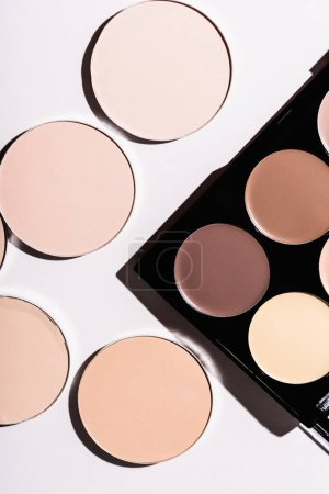 top view of contour palette and face power on white background