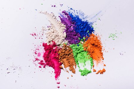 Photo for Top view of multicolored eyeshadow powder on white background - Royalty Free Image