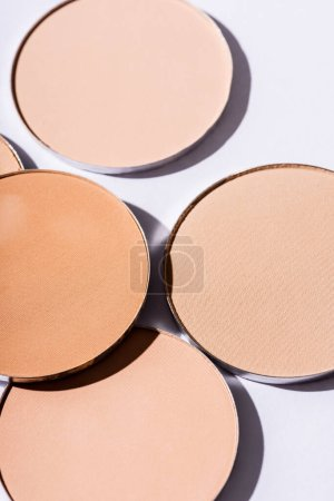 close up view of face powder on white background