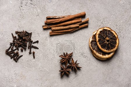 Flat lay with spices on textured and grey background