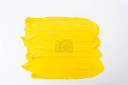 Photo for Top view of abstract colorful yellow paint brushstrokes on white background - Royalty Free Image