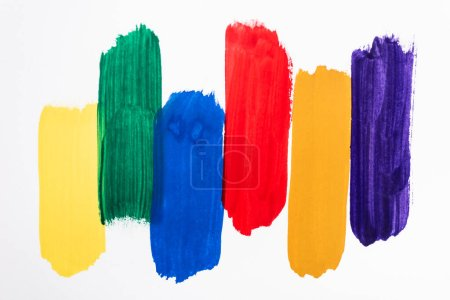 Photo for Top view of abstract colorful paint brushstrokes on white background - Royalty Free Image