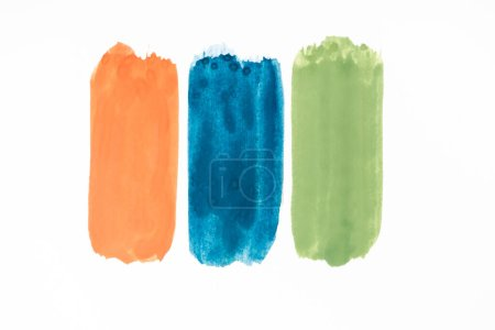 Photo for Top view of abstract colorful green, orange and blue paint brushstrokes on white background - Royalty Free Image