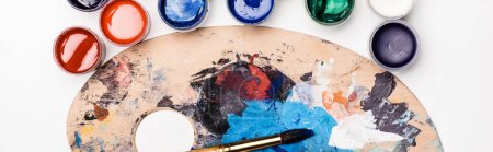 Photo for Top view of palette with Gouache paints and paintbrush on white background, panoramic shot - Royalty Free Image