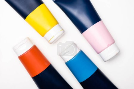 Photo for Top view of acrylic paint tubes on white background - Royalty Free Image