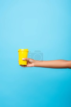 Photo for Partial view of african american woman holding reusable mug isolated on blue - Royalty Free Image