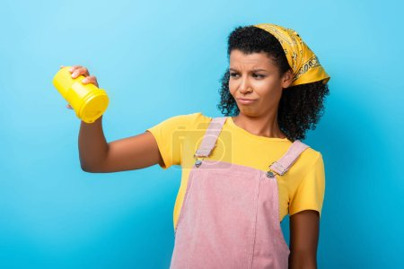 Photo for Displeased african american woman holding empty reusable mug on blue - Royalty Free Image
