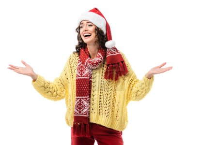 Photo for Excited woman in santa hat and scarf with ornament gesturing isolated on white - Royalty Free Image