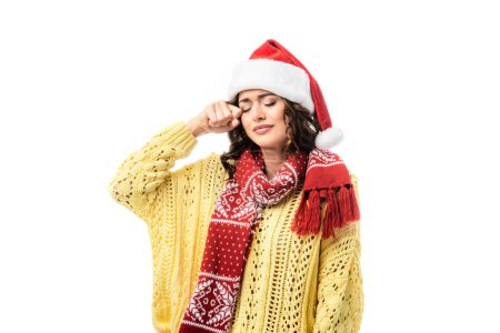 Photo for Sad woman in santa hat and scarf with ornament crying isolated on white - Royalty Free Image