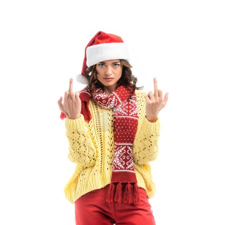 Photo for Woman in santa hat and scarf showing middle fingers isolated on white - Royalty Free Image