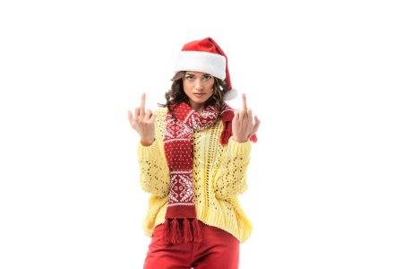 Photo for Young woman in santa hat and scarf showing middle fingers isolated on white - Royalty Free Image