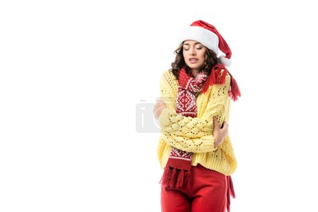 Photo for Young freezing woman in santa hat and scarf standing isolated on white - Royalty Free Image