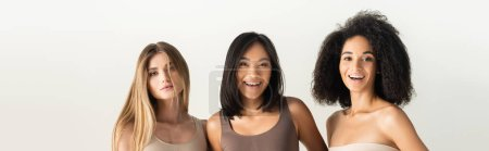 Photo for Young interracial women laughing isolated on white, banner - Royalty Free Image
