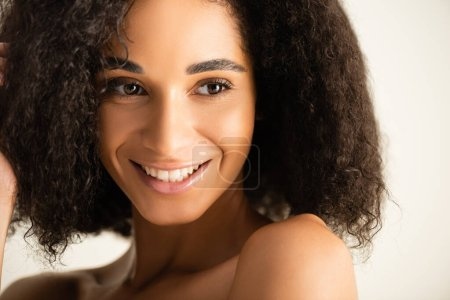 African american woman smiling and looking away isolated on white