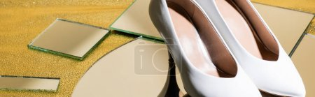 Photo for Elegant white heeled shoes on mirror surface, banner - Royalty Free Image