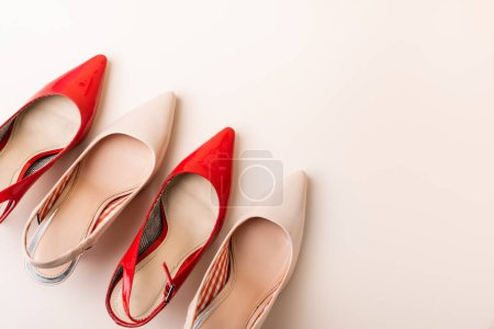 top view of leather heeled shoes on beige background