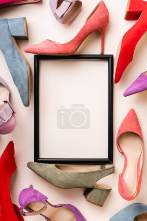 Photo for Top view of heeled shoes and empty frame on white background - Royalty Free Image