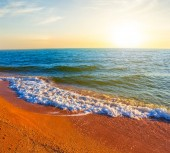 sandy sea beach at the sunset, natural vacation background