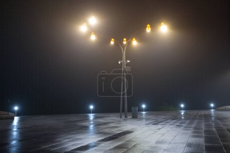 Photo for Lantern stay on a town square in a mist, night city scene - Royalty Free Image