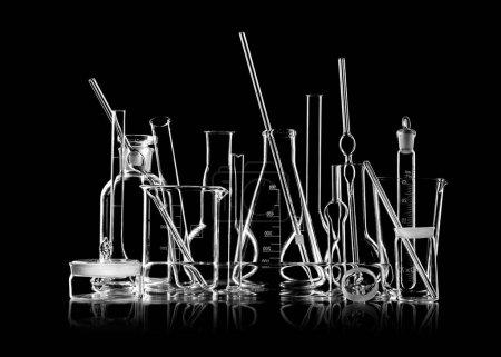 group object of laboratory limpid glassware,  black-and-white horizontal photo