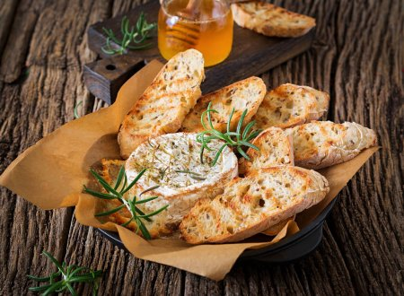 Photo for Baked cheese Camembert with rosemary and honey. Tasty food. - Royalty Free Image