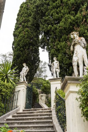 Achilleion palace, Corfu, Greece - August 24, 2018: Classical statues at the Achillion Palace on the island of Corfu.