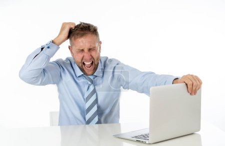 Photo for Business, people, deadline and technology concept - stressed entrepreneur businessman with laptop computer at office feeling angry and desperate. - Royalty Free Image