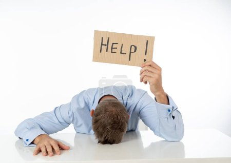 Businessman holding help sign message
