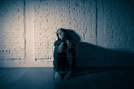 Photo for Young devastated depressed woman crying sad feeling hurt suffering depression in sadness emotion in pain and desperate expression. loneliness, depression and heartbroken concept - Royalty Free Image