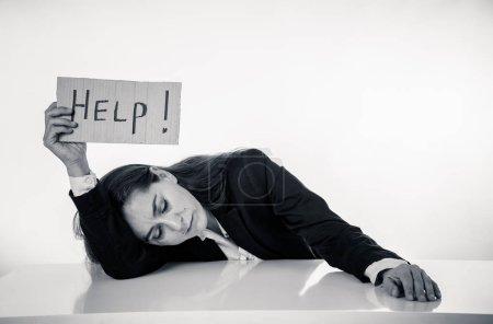 Sad businesswoman holding a help sign