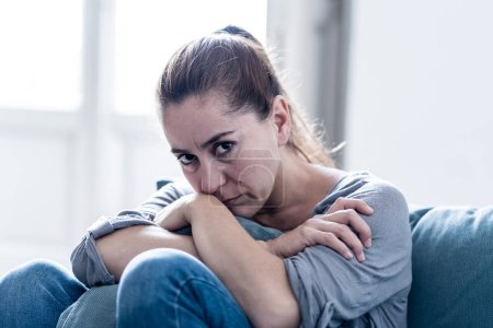 Photo for Young attractive latin woman lying at home living room couch feeling sad tired and worried suffering depression in mental health, problems and broken heart concept. - Royalty Free Image