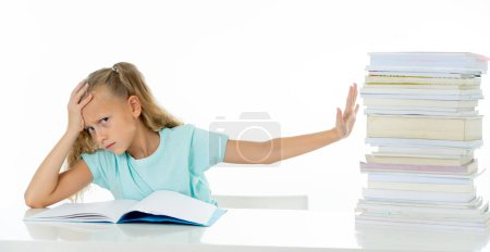 Photo for Beautiful school girl trying to study. Having too many homework that It's driving her crazy. Children education concept isolated on white background - Royalty Free Image