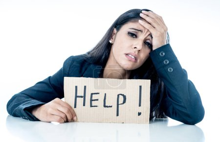 Photo for Young beautiful latin business woman overwhelmed and tired holding a help sign. looking Stressed, bored, frustrated, upset and unhappy at work. business frustration concept - Royalty Free Image