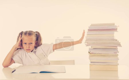 Photo for Frustrated little schoolgirl feeling a failure unable to concentrate in reading and writing difficulties learning problem attentional disorders special needs and low academic performance concept. - Royalty Free Image