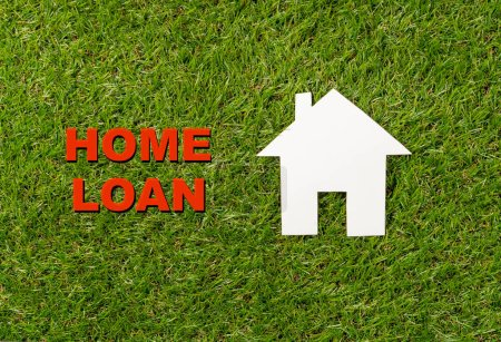 Photo for Conceptual picture of white house and text Home Loan written on green grass field top view and copy space in Property investment Real estate Saving and buying a home mortgage and loan banking concept. - Royalty Free Image