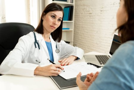 Photo for Female family doctor listening carefully to woman patient problems and symptoms in partnership, health care and medical treatment psychiatry communication and trust concept. - Royalty Free Image