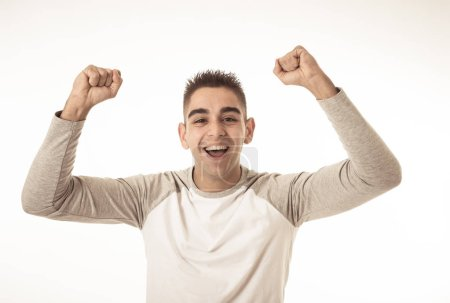Photo for Portrait of young man celebrating achieving his goal, wining the lottery or having great success in face expression human emotions and surprised and happy facial expression isolated on grey. - Royalty Free Image