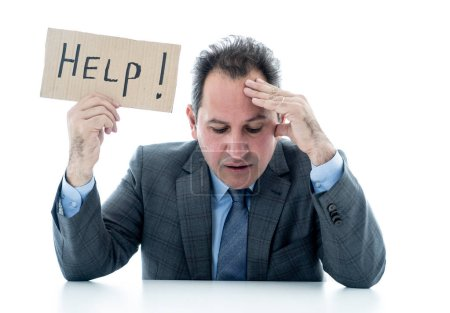 Photo for Depressed middle aged caucasian businessman desperate and tired holding a help sign looking frustrated, upset and unhappy. In business and stress at work frustration and unemployment concept. - Royalty Free Image