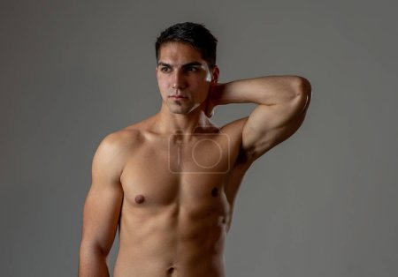 Photo for Portrait of strong sexy handsome Athletic man. Studio shot of Mixed race latin fitness model posing for sports, beauty or fashion advertisement. In exercise, healthy lifestyle, workout and body care. - Royalty Free Image