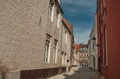 Quiet empty street with brick buildings at Bruges