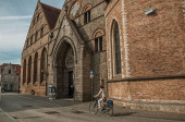 Old brick building and cyclist in Bruges