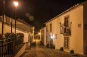 Facade of old houses with light post at dusk in Marvao
