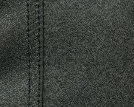 dark gray leather background with a seam for Your design-works