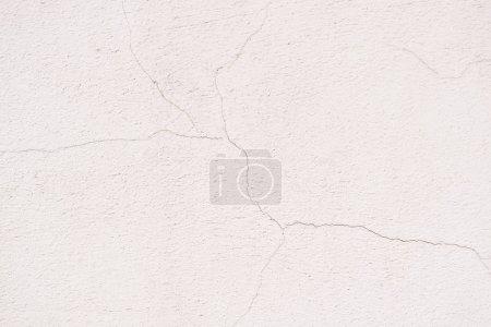 Photo pour Image plein cadre de fond de mur blanc fissuré - image libre de droit
